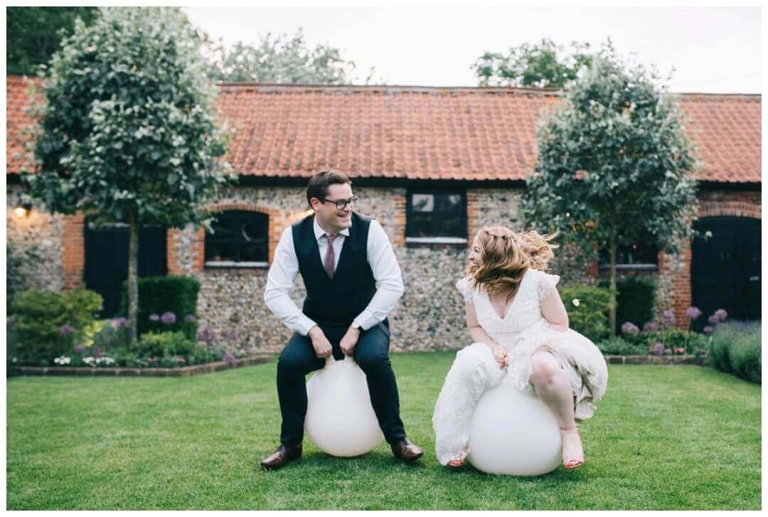 Granary Estate Wedding Photographer, Couple on space hoppers