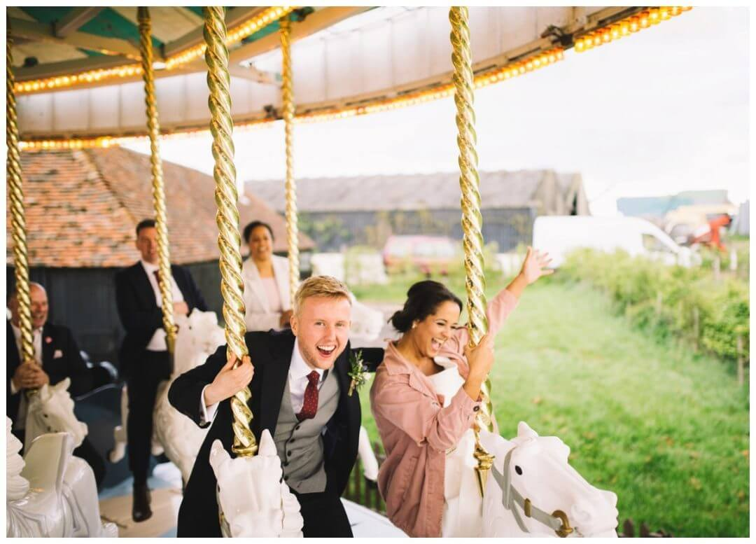 Preston Court Wedding Photography - Couple on the Carousel